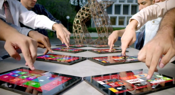 Microsoft-Surface-ad-multiple-devices-hands-001
